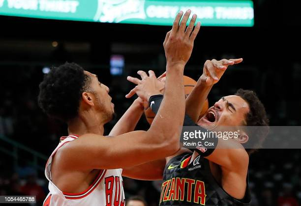 Trae Young of the Atlanta Hawks attempts to drive against Cameron Payne of the Chicago Bulls at State Farm Arena on October 27 2018 in Atlanta...
