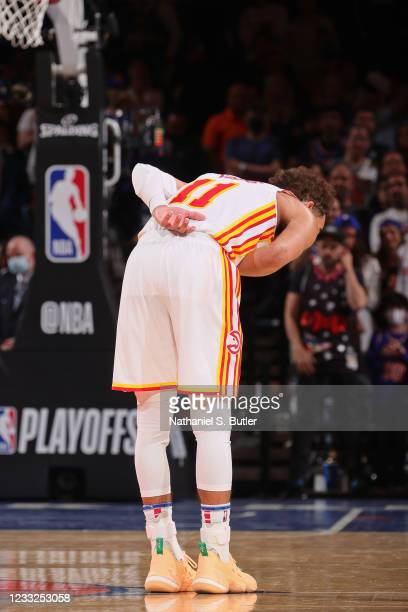 Trae Young of the Atlanta Hawks bows to the crowd against the New York Knicks during Round 1, Game 5 of the 2021 NBA Playoffs on June 2, 2021 at...