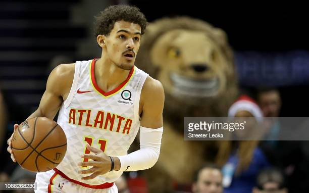 Trae Young of the Atlanta Hawks brings the ball up the court against the Charlotte Hornets during their game at Spectrum Center on November 28 2018...