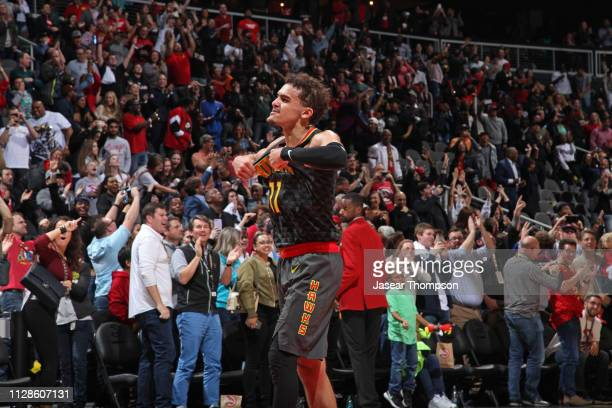 Trae Young of the Atlanta Hawks celebrates a shot during the game against the Chicago Bulls on March 1 2019 at State Farm Arena in Atlanta Georgia...