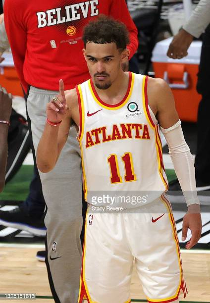Trae Young of the Atlanta Hawks celebrates a win against the Milwaukee Bucks in game one of the Eastern Conference Finals at Fiserv Forum on June 23,...