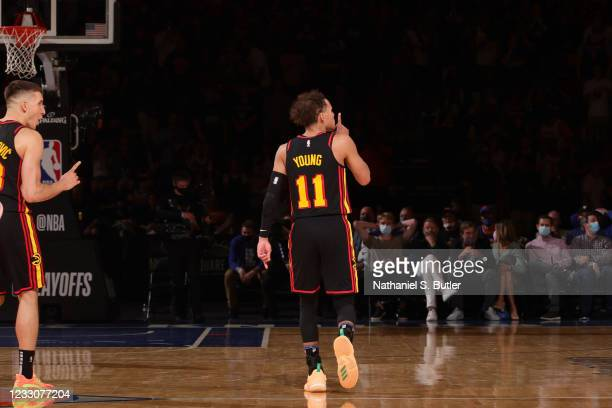 Trae Young of the Atlanta Hawks celebrates after hitting a game winning shot against the New York Knicks during Round 1, Game 1 of the 2021 NBA...