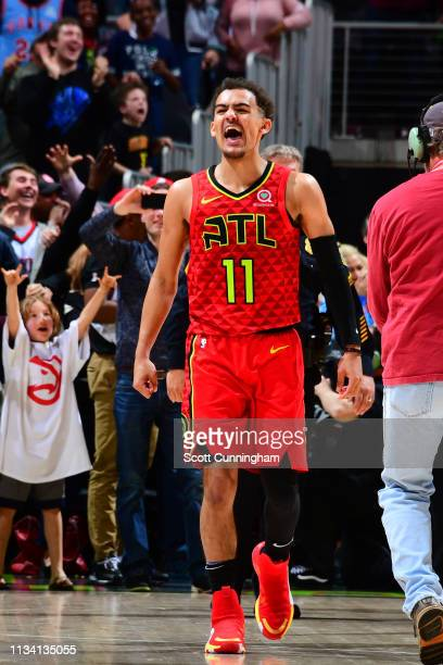 Trae Young of the Atlanta Hawks celebrates after the game against the Milwaukee Bucks on March 31 2019 at State Farm Arena in Atlanta Georgia NOTE TO...