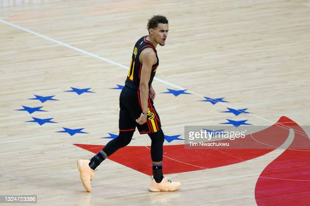 Trae Young of the Atlanta Hawks celebrates during the fourth quarter against the Philadelphia 76ers during Game Seven of the Eastern Conference...
