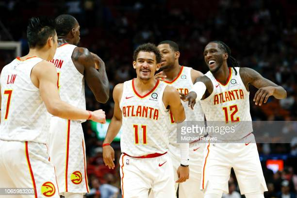 Trae Young of the Atlanta Hawks celebrates with teammates after a basket against the Miami Heat during the second half at American Airlines Arena on...