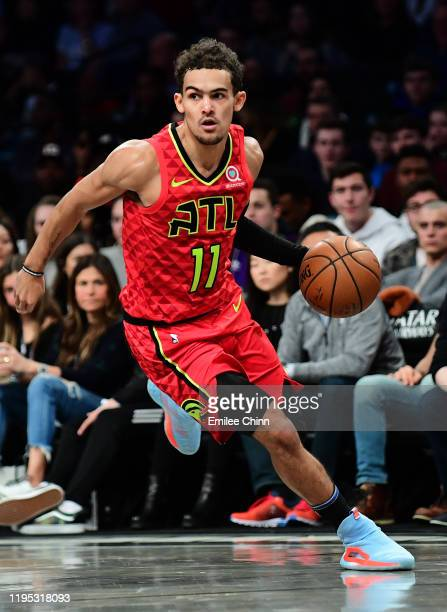 Trae Young of the Atlanta Hawks controls the ball during the second half of their game against the Brooklyn Nets at Barclays Center on December 21...