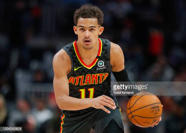 Trae Young of the Atlanta Hawks controls the ball during the second half of an NBA game against the Portland Trail Blazers at State Farm Arena on...