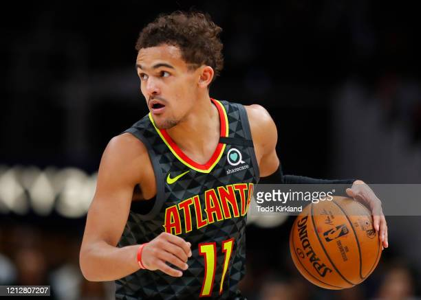 Trae Young of the Atlanta Hawks controls the ball during the second half of an NBA game against the Charlotte Hornets at State Farm Arena on March 9...