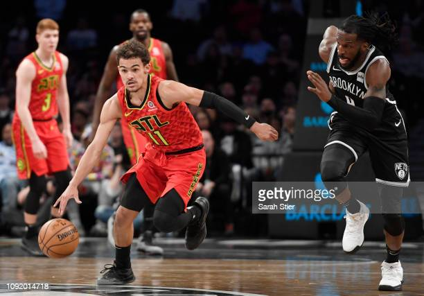 Trae Young of the Atlanta Hawks dribbles the ball against DeMarre Carroll of the Brooklyn Nets during the first quarter of the game at Barclays...