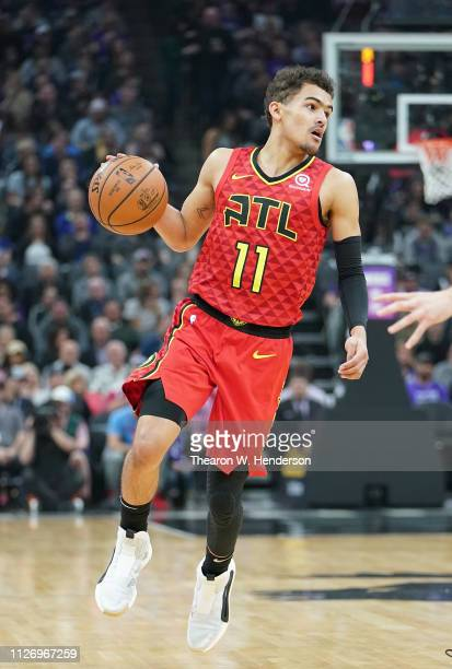 Trae Young of the Atlanta Hawks dribbles the ball against the Sacramento Kings during an NBA basketball game at Golden 1 Center on January 30 2019 in...