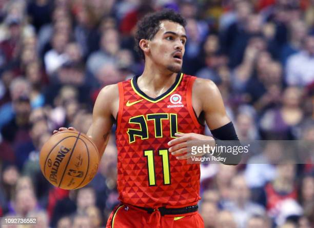 Trae Young of the Atlanta Hawks dribbles the ball during the first half of an NBA game against the Toronto Raptors at Scotiabank Arena on January 8...