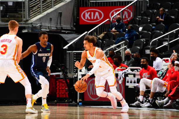 Trae Young of the Atlanta Hawks dribbles the ball during the game against the Dallas Mavericks on February 3, 2021 at State Farm Arena in Atlanta,...