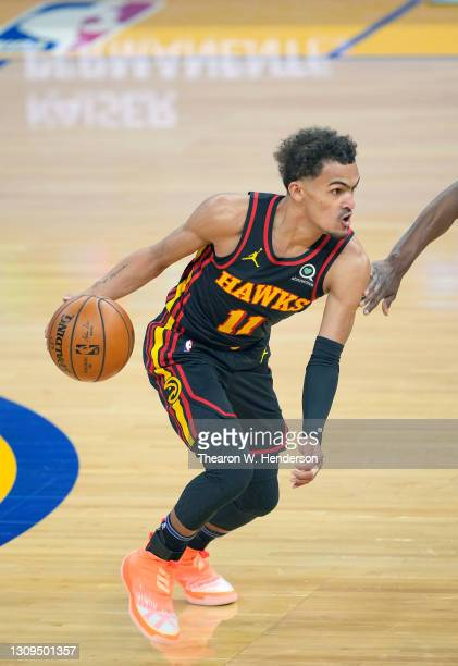 Trae Young of the Atlanta Hawks dribbling the ball against the Golden State Warriors during the first half of an NBA basketball game at Chase Center...