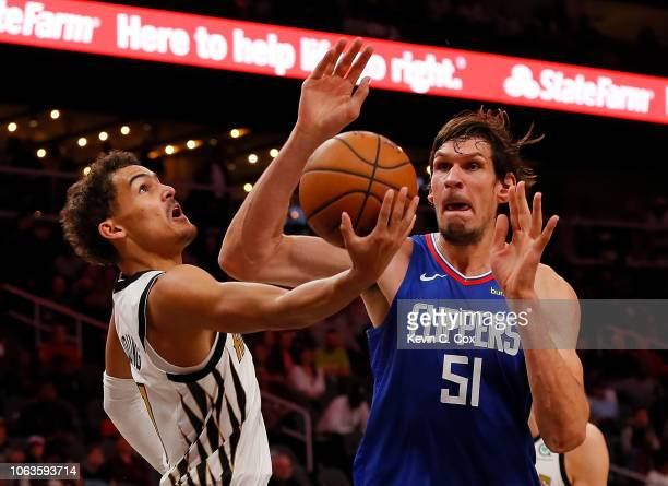 Trae Young of the Atlanta Hawks drives against Boban Marjanovic of the LA Clippers at State Farm Arena on November 19 2018 in Atlanta Georgia NOTE TO...