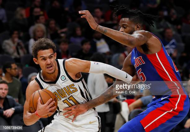 Trae Young of the Atlanta Hawks drives against Reggie Bullock of the Detroit Pistons at State Farm Arena on November 9 2018 in Atlanta Georgia NOTE...