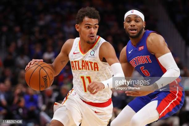 Trae Young of the Atlanta Hawks drives around Bruce Brown of the Detroit Pistons during the first half at Little Caesars Arena on October 24 2019 in...