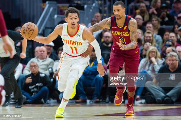Trae Young of the Atlanta Hawks drives past George Hill of the Cleveland Cavaliers during the first half at Quicken Loans Arena on October 21 2018 in...
