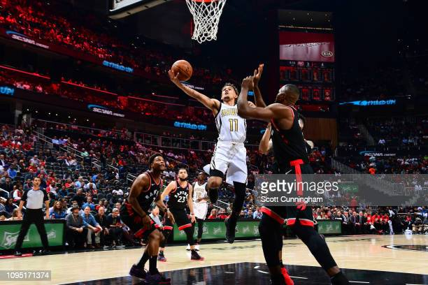 Trae Young of the Atlanta Hawks drives to the basket against the Toronto Raptors on February 7 2019 at State Farm Arena in Atlanta Georgia NOTE TO...