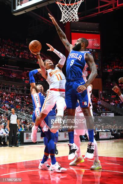 Trae Young of the Atlanta Hawks drives to the basket against the Philadelphia 76ers on October 28, 2019 at State Farm Arena in Atlanta, Georgia. NOTE...
