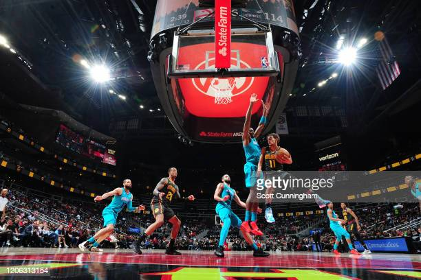 Trae Young of the Atlanta Hawks drives to the basket against the Charlotte Hornets on March 9, 2020 at State Farm Arena in Atlanta, Georgia. NOTE TO...