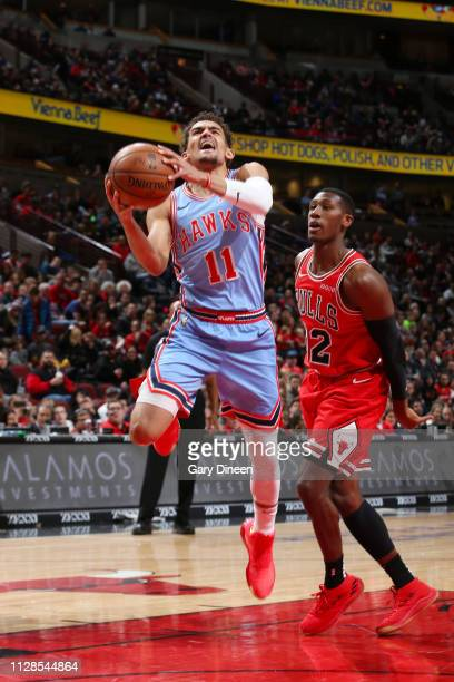 Trae Young of the Atlanta Hawks drives to the basket during the game against Kris Dunn of the Chicago Bulls on March 3 2019 at the United Center in...