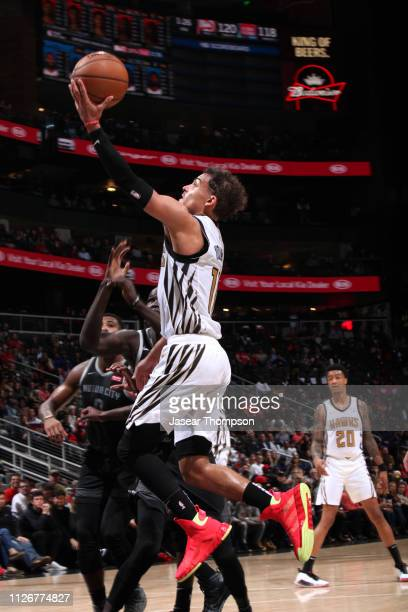 Trae Young of the Atlanta Hawks drives to the basket for layup against the Detroit Pistons on February 22 2019 at State Farm Arena in Atlanta Georgia...
