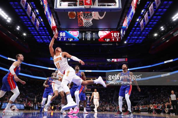Trae Young of the Atlanta Hawks drives to the basket past Derrick Rose of the Detroit Pistons during the second half at Little Caesars Arena on...