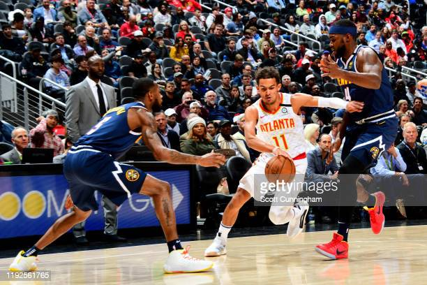 Trae Young of the Atlanta Hawks handles the ball against the Denver Nuggets on January 6, 2020 at State Farm Arena in Atlanta, Georgia. NOTE TO USER:...
