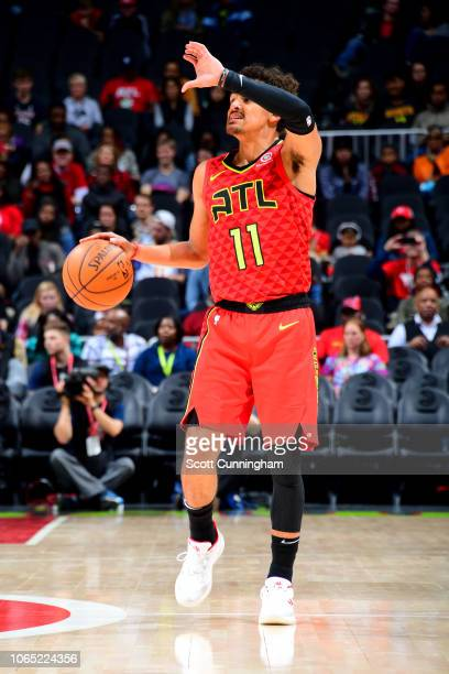 Trae Young of the Atlanta Hawks handles the ball against the Charlotte Hornets on November 25 2018 at State Farm Arena in Atlanta Georgia NOTE TO...