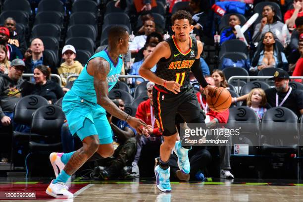 Trae Young of the Atlanta Hawks handles the ball against the Charlotte Hornets on March 9, 2020 at State Farm Arena in Atlanta, Georgia. NOTE TO...