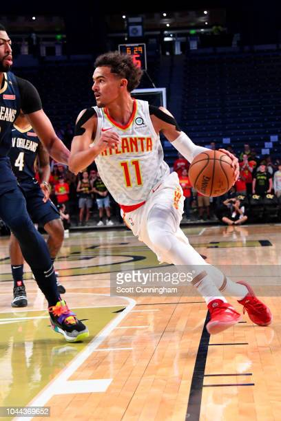Trae Young of the Atlanta Hawks handles the ball against the the New Orleans Pelicans during a preseason game on October 1 2018 at McCamish Pavilion...