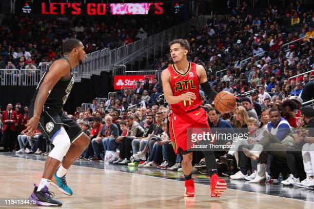 Trae Young of the Atlanta Hawks handles the ball during the game against Sterling Brown of the Milwaukee Bucks on March 31 2019 at State Farm Arena...