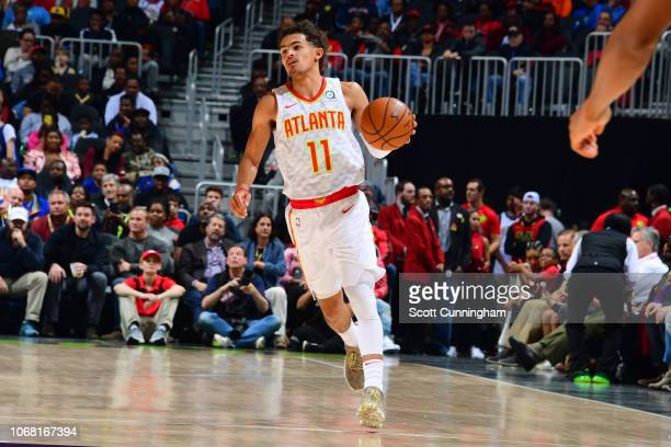Trae Young of the Atlanta Hawks handles the ball during the game against the Golden State Warriors on December 3 2018 at State Farm Arena in Atlanta...