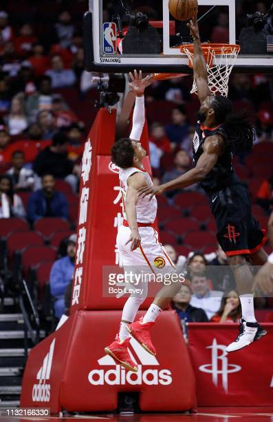 Trae Young of the Atlanta Hawks has his shot blocked by Kenneth Faried of the Houston Rockets during the second quarter at Toyota Center on February...