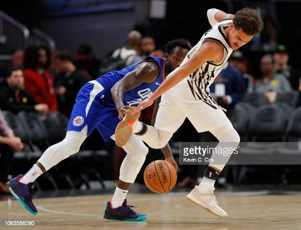 Trae Young of the Atlanta Hawks has the ball knocked away by Patrick Beverley of the LA Clippers at State Farm Arena on November 19 2018 in Atlanta...