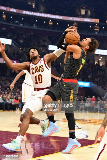 Trae Young of the Atlanta Hawks is fouled by Darius Garland of the Cleveland Cavaliers during the first half at Rocket Mortgage Fieldhouse on...