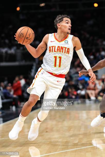 Trae Young of the Atlanta Hawks looks to pass during a preseason game against the New Orleans Pelicans at State Farm Arena on October 7, 2019 in...