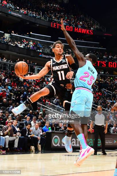 Trae Young of the Atlanta Hawks looks to pass the ball against the Miami Heat on February 20, 2020 at State Farm Arena in Atlanta, Georgia. NOTE TO...