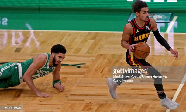 Trae Young of the Atlanta Hawks looses Jayson Tatum of the Boston Celtics during the first quarter of the NBA game at the TD Garden on February 17,...