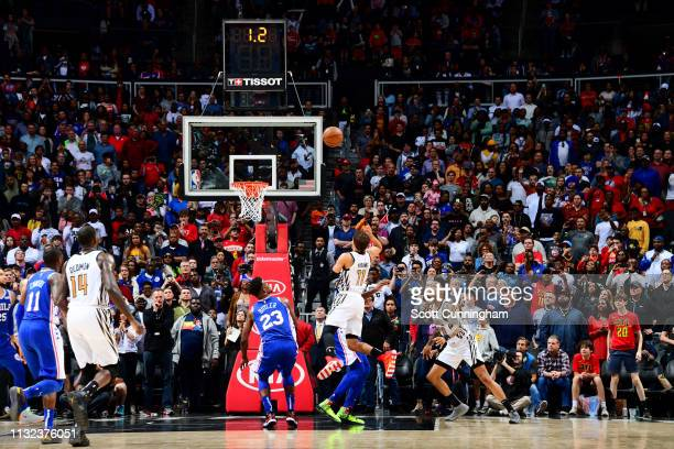 Trae Young of the Atlanta Hawks makes the game winning basket during the game against the Philadelphia 76ers on March 23 2019 at State Farm Arena in...