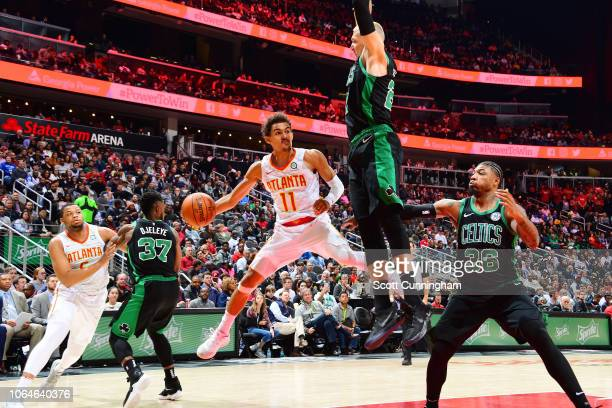 Trae Young of the Atlanta Hawks passes hose ball against the Boston Celtics on November 23 2018 at State Farm Arena in Atlanta Georgia NOTE TO USER...