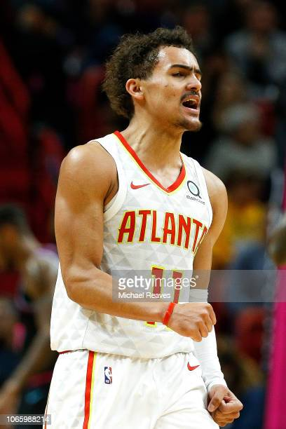 Trae Young of the Atlanta Hawks reacts after a basket against the Miami Heat during the second half at American Airlines Arena on November 27 2018 in...