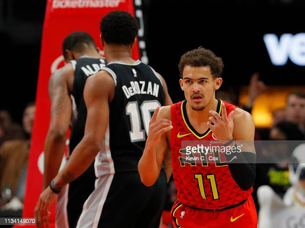 Trae Young of the Atlanta Hawks reacts after a basket against the San Antonio Spurs in the second half at State Farm Arena on March 06 2019 in...