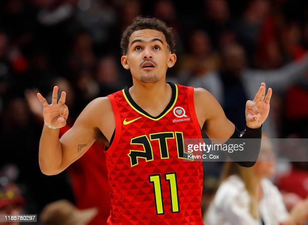 Trae Young of the Atlanta Hawks reacts after a threepoint shot during a foul in the second half against the San Antonio Spurs at State Farm Arena on...