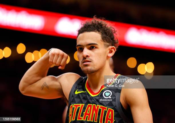 Trae Young of the Atlanta Hawks reacts after drawing a foul on a basket in the second half against the New York Knicks at State Farm Arena on...