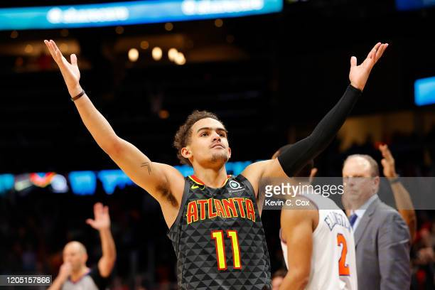 Trae Young of the Atlanta Hawks reacts after hitting a threepoint basket in double overtime against the New York Knicks at State Farm Arena on...