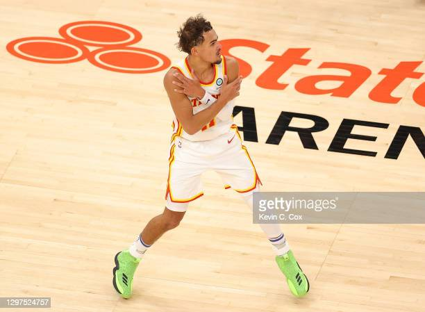 Trae Young of the Atlanta Hawks reacts after hitting a three-point basket in the final seconds of their 123-115 win over the Detroit Pistons during...