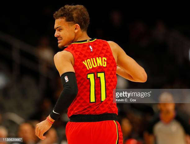 Trae Young of the Atlanta Hawks reacts after hitting a threepoint basket against the Memphis Grizzlies at State Farm Arena on March 13 2019 in...