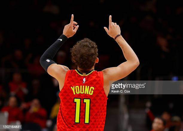 Trae Young of the Atlanta Hawks reacts after hitting a threepoint basket against the Washington Wizards in the second half at State Farm Arena on...