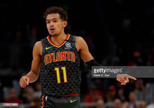 Trae Young of the Atlanta Hawks reacts after hitting a threepoint basket against the Orlando Magic in the first half at State Farm Arena on February...
